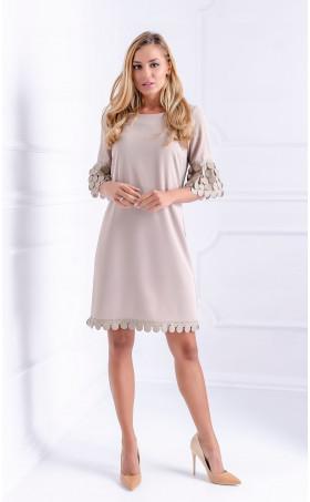 Елегантна рокля с кожени орнаменти